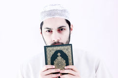 Arab muslim man with koran holy book Royalty Free Stock Image