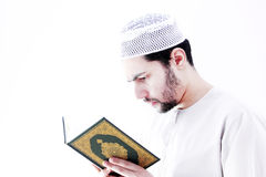 Arab muslim man with koran holy book Royalty Free Stock Photo