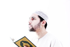 Arab muslim man with koran holy book Royalty Free Stock Photos