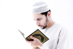Arab muslim man with koran holy book. Arab egyptian muslim man wearing islamic clothes and holding koran holy book Stock Photography