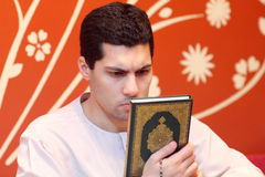 Arab muslim man with koran holy book Royalty Free Stock Photos