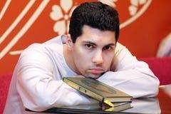 Arab muslim man with koran holy book Stock Images