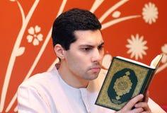 Arab muslim man with koran holy book royalty free stock images