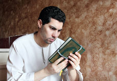 Arab muslim man with koran holy book with rosary Royalty Free Stock Photography