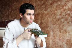 Arab muslim man with koran holy book with rosary Stock Images