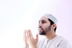 Arab muslim man with rosary praying for help Stock Photos