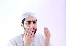 Arab muslim man with rosary praying for help Stock Images