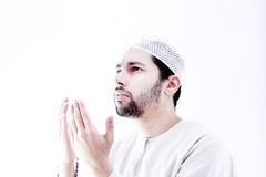 Arab muslim man with rosary praying for help Stock Photo