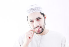 Arab muslim man with toothbrush miswak. Arab egyptian muslim man wearing islamic clothes and holding islamic toothbrush miswak Royalty Free Stock Photography