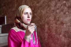 Arab muslim woman asking allah with rosary. Arabian egyptian muslim woman asking allah and searching hope with rosary in hand Stock Images