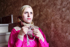 Arab muslim woman asking allah with rosary. Arabian egyptian muslim woman asking allah and searching hope with rosary in hands Stock Photos