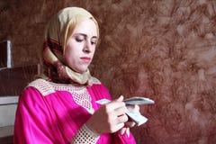 Arab muslim woman counting money Stock Photos