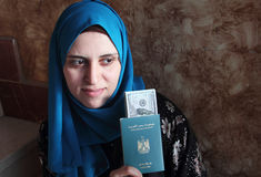 Arab muslim woman with egypt passport with money Stock Image