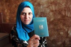 Arab muslim woman with egypt passport Stock Photo