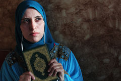 Arab muslim woman with Koran islamic holy book and headset Stock Images