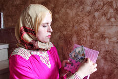 Arab muslim woman with money Stock Photography