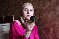 Arab muslim woman with pistol Royalty Free Stock Photo