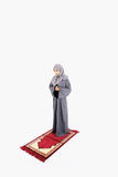 Arab muslim woman praying. On a praying carpet. Isolated on white background Stock Photography