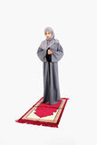Arab muslim woman praying. On a praying carpet. Isolated on white background Stock Images