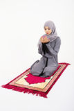 Arab muslim woman praying. On a praying carpet.  on white background Stock Photography
