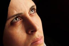 Arab muslim woman staring. Portrait of arabian egyptian muslim woman staring with sharp eyes Stock Image