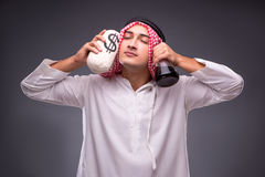 The arab with oil on gray background Royalty Free Stock Images