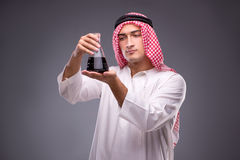 The arab with oil on gray background Royalty Free Stock Image