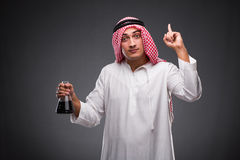 The arab with oil on gray background Stock Image