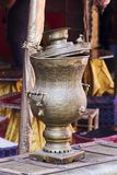 Arab old brass kettle. Over an old travel trunk Royalty Free Stock Image