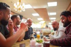 Arab people enjoying a traditional Iftar meal stock photo