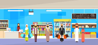 Arab People Group With Bags Big Shop Super Market Shopping Mall Interior Muslim Customers Stand In Line Royalty Free Stock Images