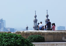 Arab people looking at islamic cairo in egypt Stock Photos