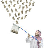 An Arab person with a fishing net catching money Royalty Free Stock Photos