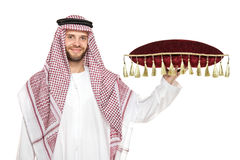 An arab person holding a pillow Royalty Free Stock Images