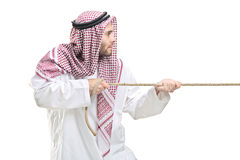 An Arab person pulling a rope. Isolated on white background royalty free stock photography