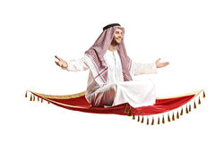 An arab person sitting on a flying carpet Royalty Free Stock Image