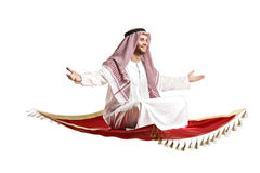 Arab person sitting on a flying carpet Royalty Free Stock Photography