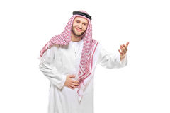 An arab person welcoming. Isolated on white background Royalty Free Stock Photo