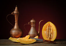 Arab pitcher and melon Stock Photography