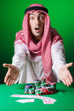 Arab playing in casino Royalty Free Stock Image