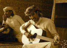 Arab playing the guitar Saudi. Yemeni boy sitting Stock Photos