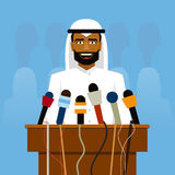 Arab politician speaking before reporters and microphones. Royalty Free Stock Photo