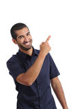 Arab promoter man presenting while pointing at side Royalty Free Stock Photos