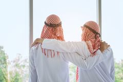 Arab saudi businessman with friend in hotel