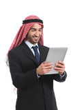 Arab saudi businessman reading a tablet reader Royalty Free Stock Photo