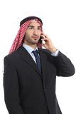 Arab saudi businessman talking on the mobile phone. Isolated on a white background Stock Image