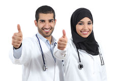 Arab saudi emirates doctors happy with thums up. Isolated on a white background Stock Photos