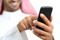 Arab saudi emirates man hand texting in a smart phone Stock Photos