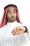 Arab saudi emirates man looking his watch too late. Isolated on a white background Stock Photography