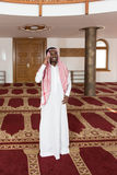 Arab Saudi Emirates Man Using A Smart Phone Royalty Free Stock Photo